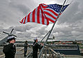 Sailors lower national ensign aboard USS Mount Whitney. (9142506771).jpg
