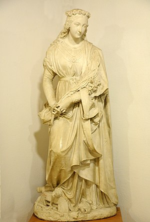Philomena - Saint Philomena with attributes: palm, whip, anchor and arrows. Plaster cast by Johann Dominik Mahlknecht in the Museum Gherdëina in Urtijëi, Italy