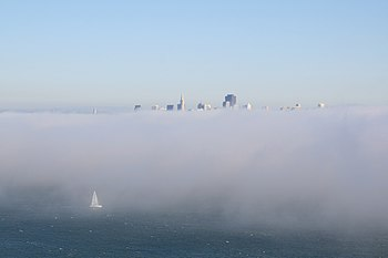 San Franciso in fog and sailboat
