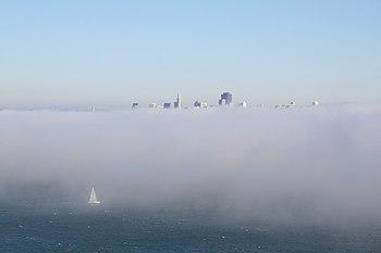San Franciso in fog and sailboat