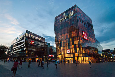 The Taikoo Li Sanlitun shopping arcade is a destination for locals and visitors Sanlitun at dusk.jpg