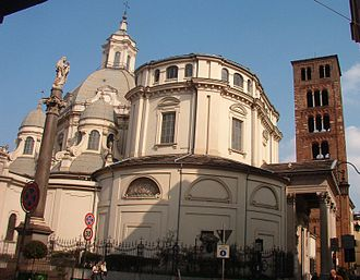 Santuario della Consolata - Outside view from the West, with domes, portico, column, and belltower.