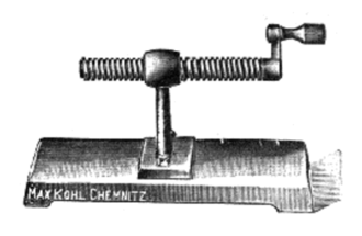 Screw (simple machine) - A machine used in schools to demonstrate the action of a screw, from 1912. It consists of a threaded shaft through a threaded hole in a stationary mount. When the crank on the right is turned, the shaft moves horizontally through the hole.