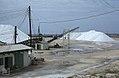 Sea salt awaiting shipping. Workers wear dark glasses or sun dazzled. (27093908579).jpg