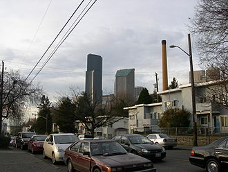 Yesler Terrace, Seattle - Yesler Way cuts through Yesler Terrace. The Columbia Center and other downtown skyscrapers can be seen in center background, and the upper part of Harborview Medical Center is just visible at right.