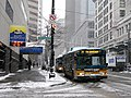 Seattle trolleybuses in snow, downtown in 2008.jpg