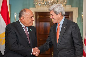 Sameh Shoukry - Shoukry (left) meets with US Secretary of State John Kerry in 2016