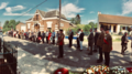 Secretary of State for Northern Ireland Karen Bradley MP lays a wreath at the memorial at Guillemont (28367423227).png