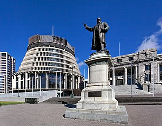 "New Zealand - A statue of Richard Seddon, the ""Beehive"" (Executive Wing), and Parliament House (right), in Parliament Grounds, Wellington."