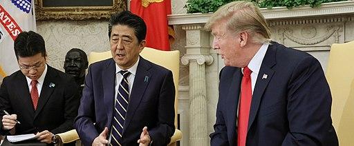 Shinzo Abe talking with Donald Trump 01