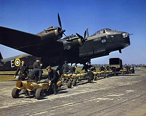 "Short Stirling - Stirling N6101 from No. 1651 Heavy Conversion Unit at Waterbeach, Cambridgeshire, being ""bombed up""."