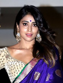 Shriya Saran looking towards the camera