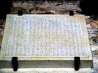 Church of San Juan Apóstol y Evangelista, Santianes de Pravia - Foundation stone in the form of a letter labyrinth: Silo princeps fecit