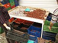 Sorting chestnuts by size on central market of Thessaloniki - panoramio.jpg