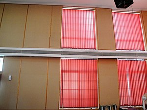 Noise control - Sound treatment panels contrast with red curtains in a church meeting hall