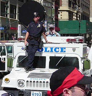 Long Range Acoustic Device - The LRAD is the round black device on top of the New York City police Hummer.