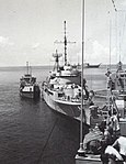 South Vietnamese Barnegat-class seaplane tender pulls alongside of USS Cook (DE-1083) in the South China Sea during Operation Frequent Wind, in late April 1975.jpg