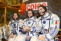 Soyuz TMA-20 Crew in front of the capsule.jpg