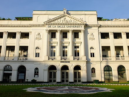De La Salle University is a Lasallian educational institution established in 1911. St. La Salle Hall Facade.JPG