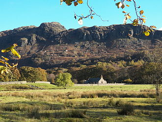 Eskdale, Cumbria - St Catherine's chapel seen from across the valley in autumn