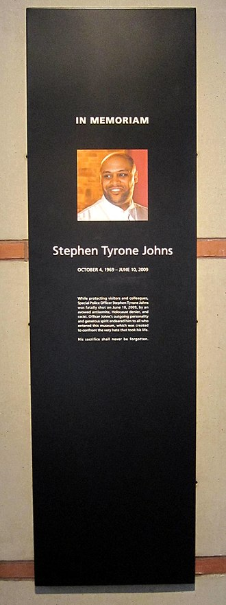 United States Holocaust Memorial Museum shooting - A sign honoring Stephen Tyrone Johns, the Special Police Officer shot and killed during the shooting, located in the museum's lobby.