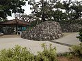 Stone walls and pavilion in Okinawa Commemorative National Government Park.JPG