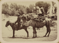Street Types of Central Asian Cities. Man on a Horse next to Two Women Riding on a Camel WDL11122.png