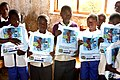 Students hold their new bed nets at Tanga Primary School, where 325 nets were distributed TZ Credit Hayley Gibson (22759291969).jpg