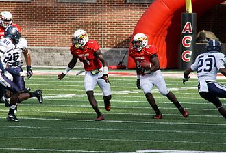 Stefon Diggs - Stefon Diggs, left, prepares to lead block for Terps running back Brandon Ross