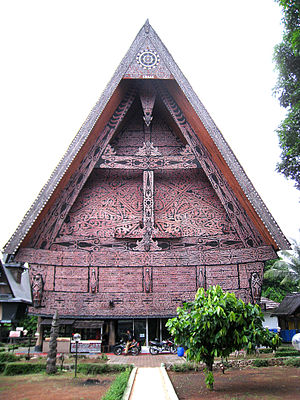 Gorga (art) - The arabesque-like red, white, and black gorga pattern decorates the facade of this Batak Toba house.