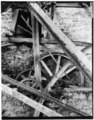 TRANSMISSION GEARING SHOWING RELATION TO SEGMENT GEAR ON WATERWHEEL william E. Barrett, photographer, 1973 (copy negative) - Thomas Shepherd's Grist Mill, High Street Vicinity, HAER WVA,19-SHEP,3-12.tif