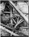 TRANSMISSION GEARING SHOWING RELATION TO SEGMENT GEAR ON WATERWHEEL william E. Barrett, photographer, 1973 (copy negative) - Thomas Shepherd's Grist Mill, High Street Vicinity, HAER WVA,19-SHEP,3-12.tif