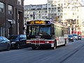 TTC bus 7793 proceeding west on the Esplanade, 2015 01 13 (1) (16093258798).jpg