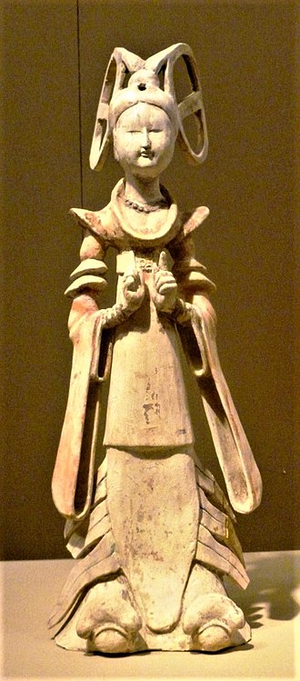 Women in ancient and imperial China - Painted female dancer with rings on head. Tang dynasty
