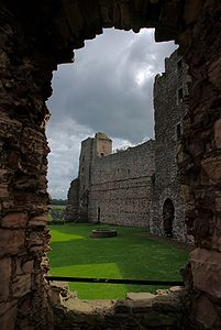 Tantallon Castle, courtyard with well and southern wing.jpg