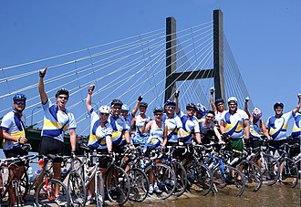 "Upper Iowa University - Upper Iowa University's ""Team Peacock"" has raised $350,000 to date riding RAGBRAI for student scholarships"