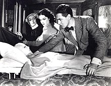 Still image of actors Lacey, Lockwood, and Redgrave from Hitchcock's tenth film titled The Lady Vanishes