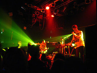 Julian Hamilton - Hamilton (right) and Kim Moyes (centre) of The Presets. Performing in London, United Kingdom, October 2006.