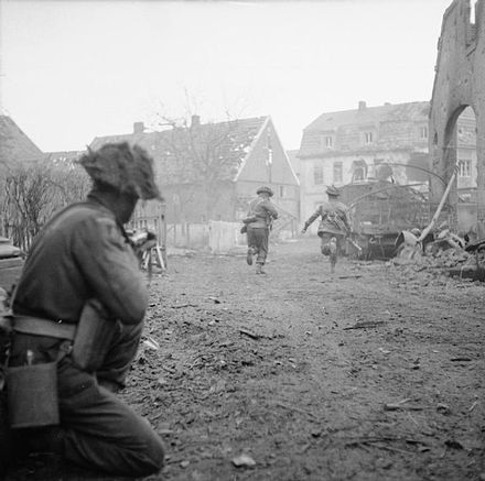 Men of the 9th Durham Light Infantry clearing resistance in the village of Weseke, Germany, 29 March 1945. The British Army in North-west Europe 1944-45 BU2836.jpg