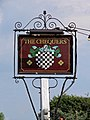 The Chequers pub sign at Matching Green, Essex, England 1.jpg