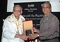The Chief Producer, Films Division Shri Kuldeep Sinha felicitating the Poet, Lyricist, Writer, Director, Shri Gulzar, during the 40th International Film Festival (IFFI-2009), at Panaji, Goa on November 27, 2009.jpg