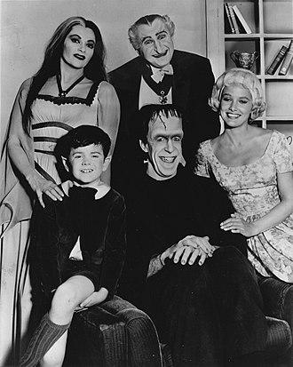 Beverley Owen - The cast of The Munsters. Standing, L–R: Yvonne De Carlo, Al Lewis. Sitting: Butch Patrick, Fred Gwynne, Beverley Owen