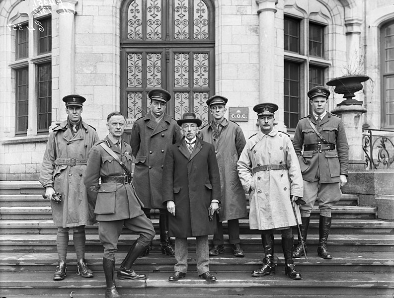 Place made:  Ham-sur-Heure, Belgium. A group portrait of the Prime Minister of Australia William Hughes and six unidentified Australian soldiers, outside the chateau which served as the Australian Corps Headquarters.