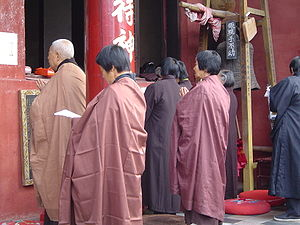 Sangha - Upāsakas and Upāsikās performing a short chanting ceremony at Three Ancestors Temple, Anhui, China