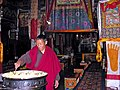 Tibet - 5578 - Monk tending to the yak butter candles.jpg