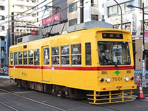Toei 7000 series - Car 7001 repainted in original yellow livery with red stripe (for two-man operation cars) in December 2013