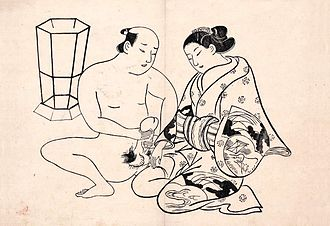 Clothed female, naked male - By the Light of a Hexagonal Lantern, woodblock print by Torii Kiyonobu I, early 1700s.