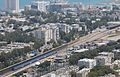 Train enters Bat Galim station, Israel.jpg