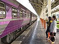 Two lovely Thai ladies on the platform (14739747282).jpg