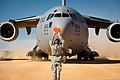 U.S. Air Force Senior Airman Douglas Prewitt, with the 621st Contingency Response Wing, marshals a C-17 Globemaster III aircraft at Geronimo Landing Zone during the Joint Readiness Training Center 14-03 field 140116-F-XL333-034.jpg